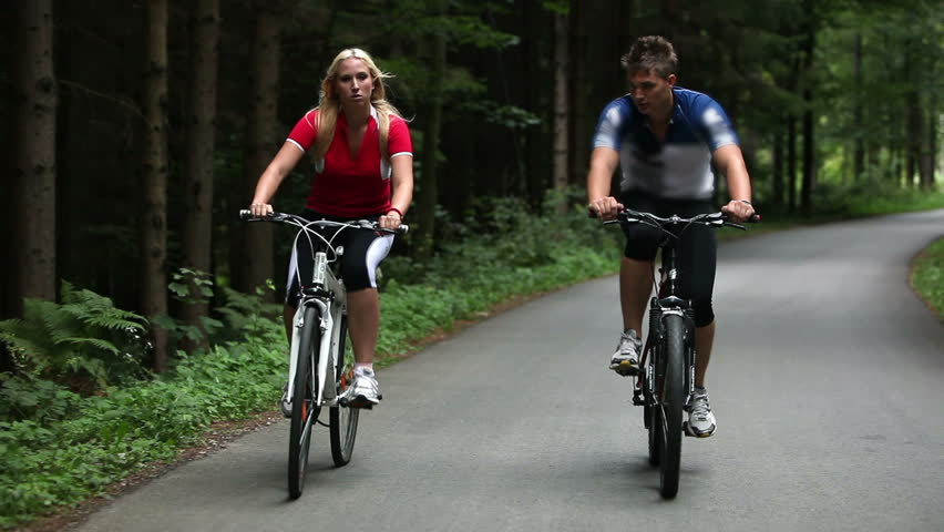 Total of young couple cycling in woods | Shutterstock HD Video #3887159