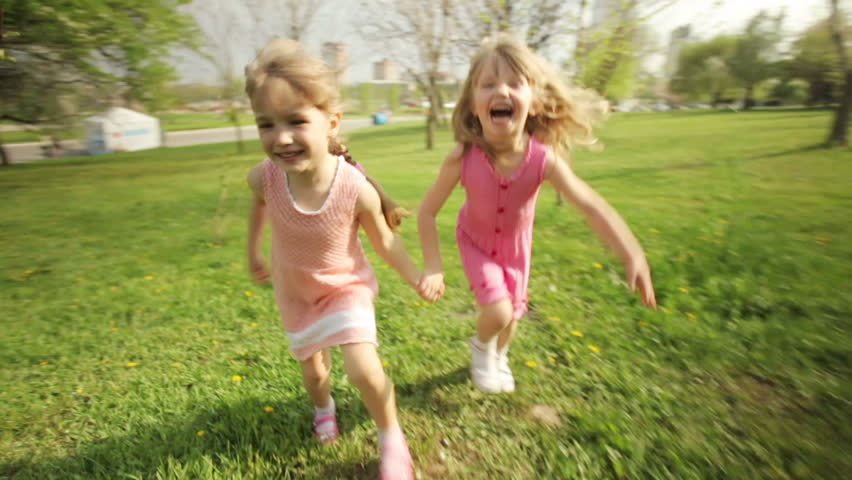 Sisters running around in garden and laughing  | Shutterstock HD Video #3889889