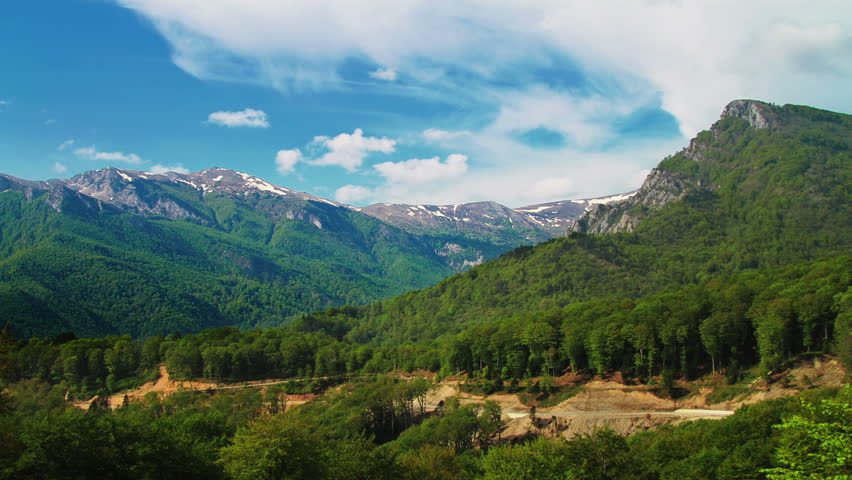 Timelapsed scenery with mountain peaks and cloudy sky | Shutterstock HD Video #3893324