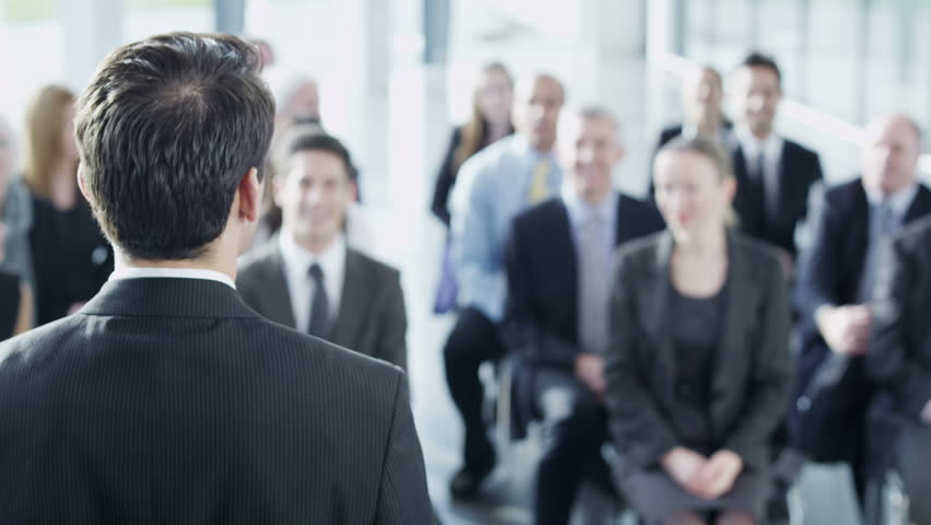 A diverse group of business people of mixed ages are listening to a presentation at a business seminar and asking questions. In slow motion.  | Shutterstock HD Video #3895604