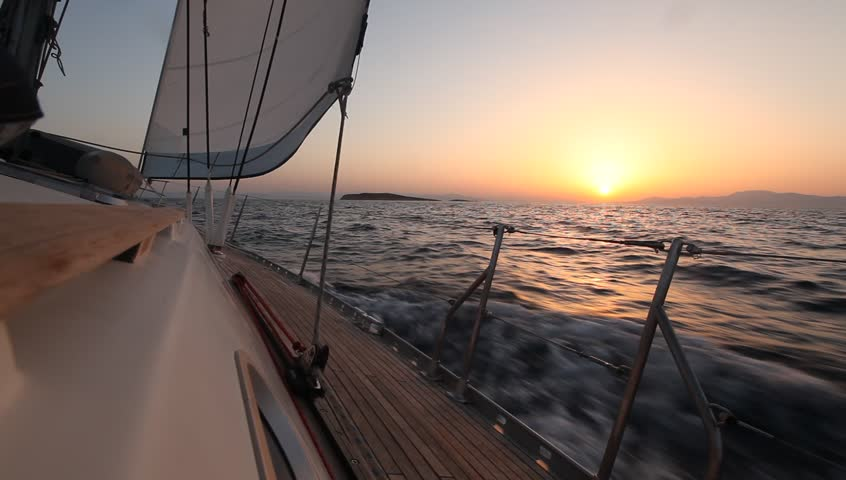 Sailing in the wind through the waves during sunset (HD) Sailing boat shot in full HD at the Sailing in the Aegean Sea.