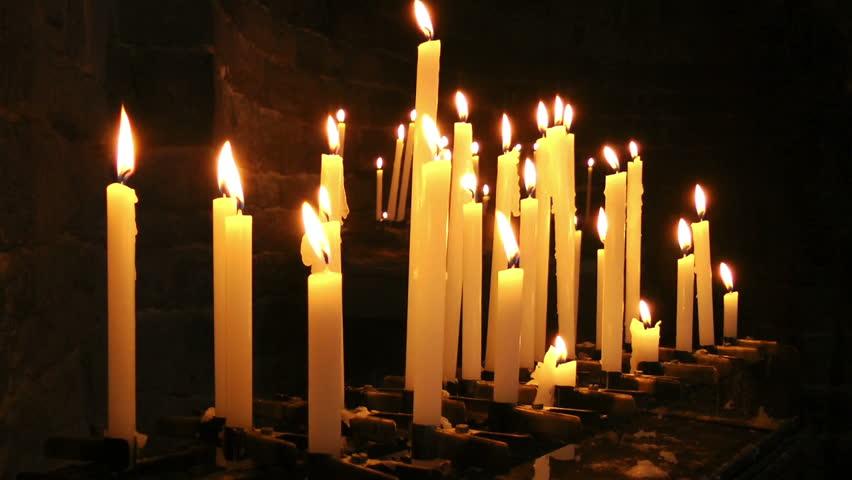 Burning candles in Saint Peter Church, Portovenere