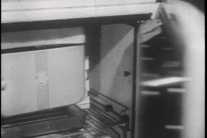 1950s - Air raid sirens sound and a family prepares to take shelter during a nuclear blast