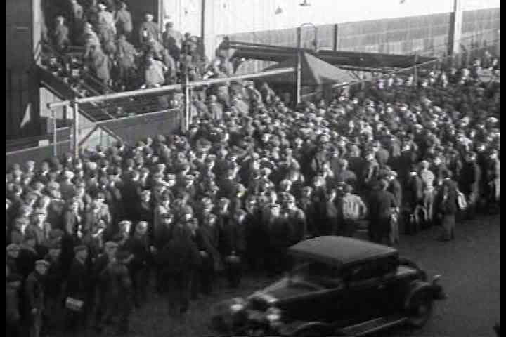 1930s - Workers stream into the General Motors automobile factory in the 1930s as whole towns spring up around the car industry in Michigan.
