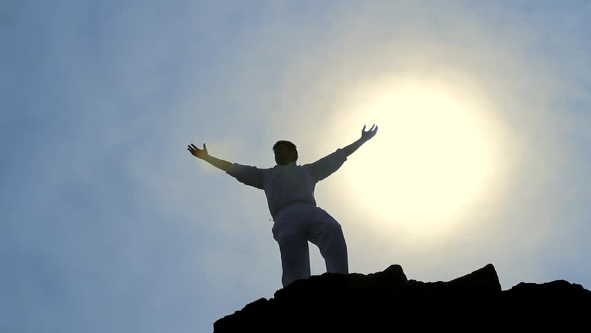 Victory Pose by Man on Top of Hill Lifting Hands at the Sun Business Background #3912062