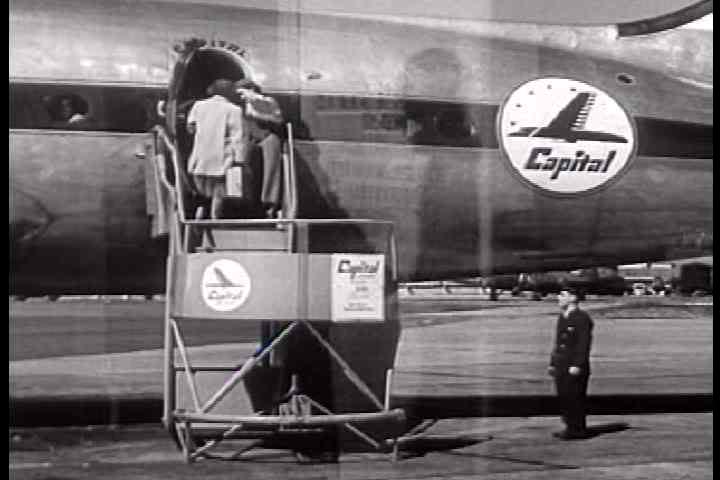 1950s - A couple boards a modern airplane in 1950 which taxis away and is seen in flight.