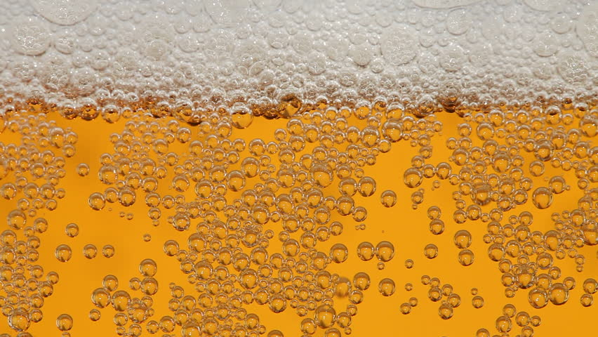 Macro of beer pouring to glass.