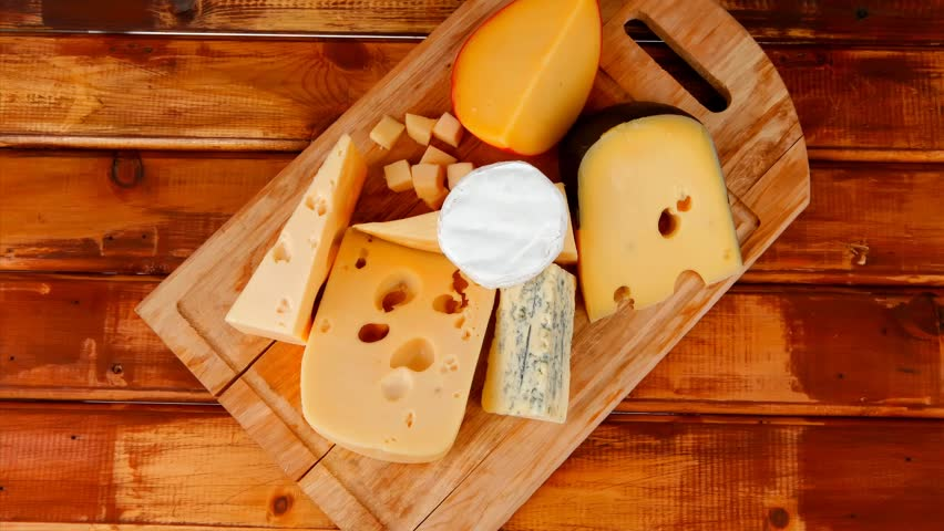Different cheeses served on wooding cutting board 1920x1080 intro motion slow hidef hd | Shutterstock HD Video #3925955