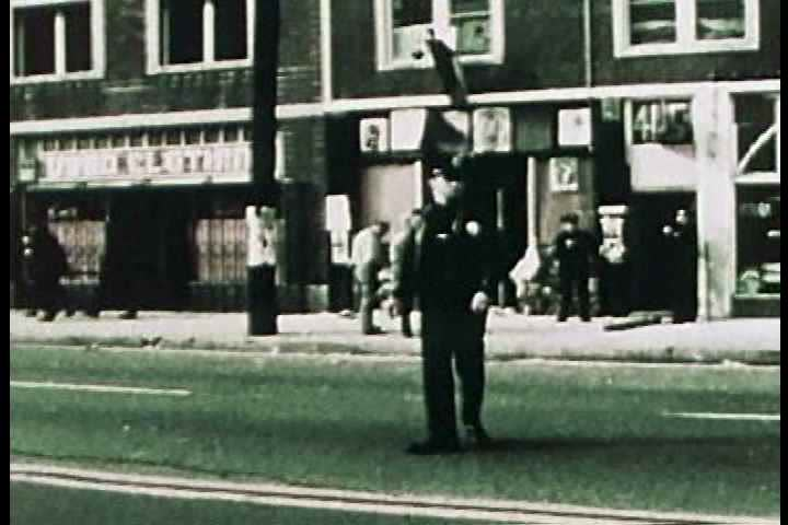 1960s - A police raid on black panther headquarters in the 1960s shows racial strife.