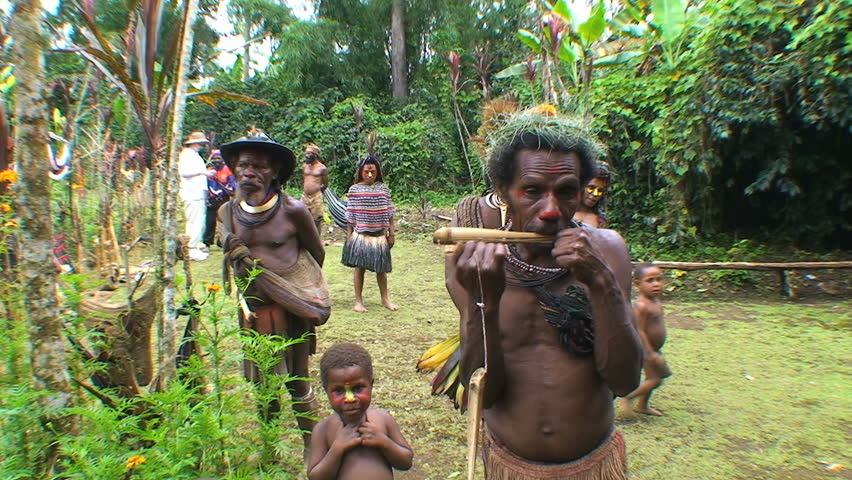 PAPUA NEW GUINEA - NOV.4: Villagers in the Mt. Hagen Highland area in Papua New Guinea, one playing a mouth harp aka juice harp. November 4, 2008.