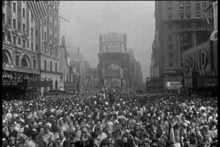 1940s - People celebrate on the streets of New York City following Japan's surrender in World War Two.