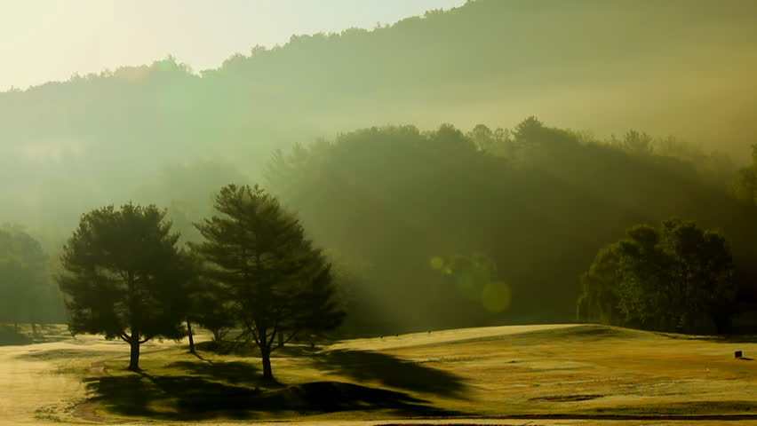 Time lapse of fog lifting off a beautiful mountain golf course