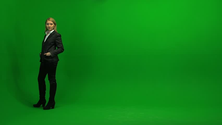blond women walking trough frame against green screen | Shutterstock Video #3954335