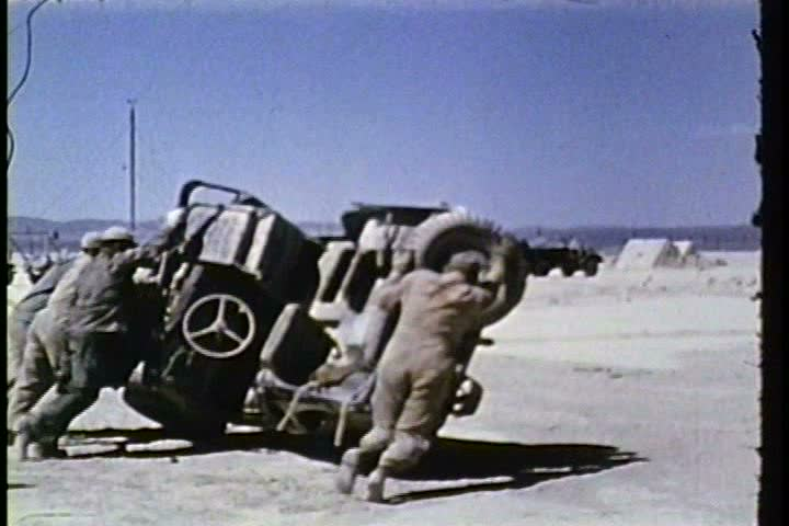 1950s - Operation Knothole nuclear tests in the Nevada desert in 1953 effects on vehicles, trucks. | Shutterstock HD Video #3955925