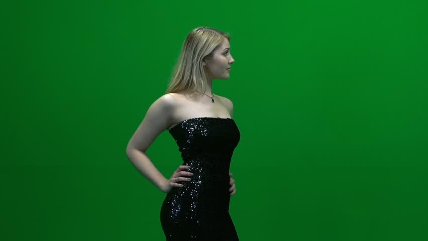 women modeling in elegant dress isolated against green screen