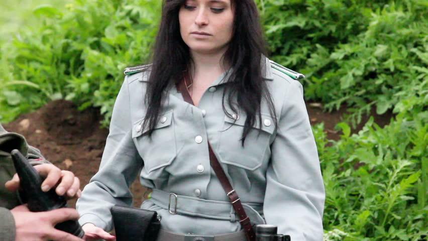 Female officer loading rocket into RPG7 - anti tank grun