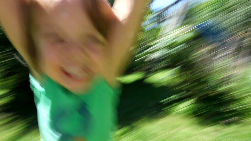 Little boy spinning around and around laughing and smiling at the end of his fathers arms on a sunny day   Shutterstock HD Video #3964747
