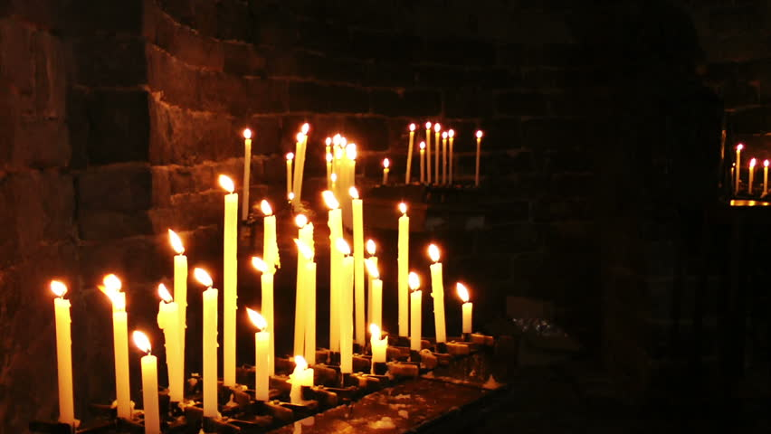 Burning candles in the Church of Saint Peter, Portovenere