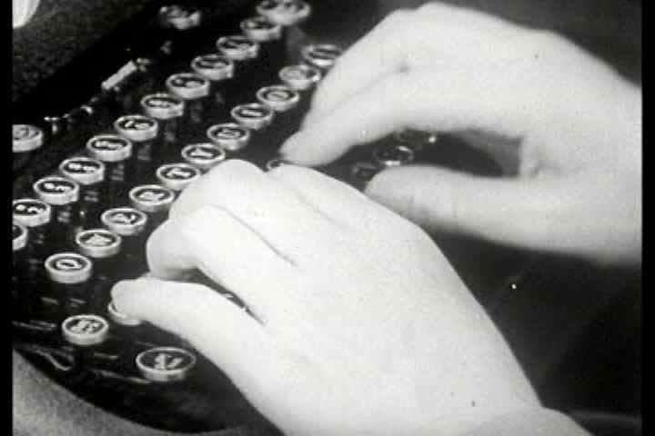 1950s - A person types very rapidly on a manual typewriter