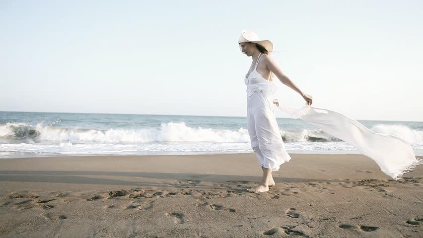 Young beautiful women in white on the beach | Shutterstock HD Video #3986248