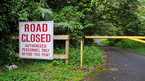 Road closed - authorized personnel only sign in abandoned road
