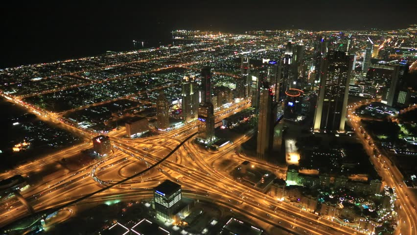 DUBAI, UAE - NOVEMBER 13: Aerial view of Downtown Dubai with man made lake and skyscrapers from the tallest building in the world, Burj Khalifa, at 828m, taken on 13 November 2012 in Dubai. | Shutterstock HD Video #3997897