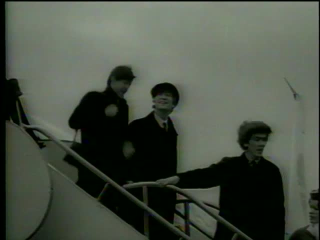 English rock'n'roll band the Beatles arrives in the USA for the first time, John F. Kennedy Airport, New York, February, 10, 1964-MGM PICTURES, UNIVERSAL-INTERNATIONAL NEWSREEL, USA, filmed in 1964