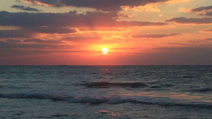Beautiful sunset at the beach, amazing colors, light beam shining through the cloudscape over the arabian gulf seascape, united arab emirates. Dubai sea and beach #4001635