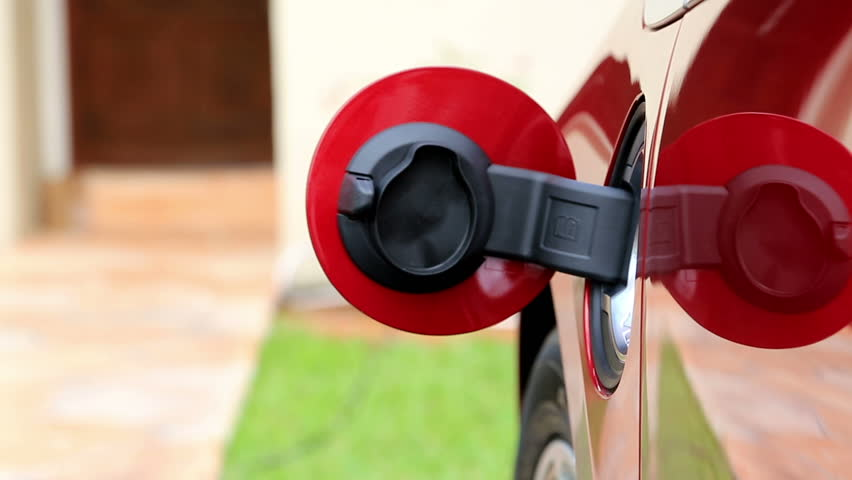 Electric vehicle being plugged in or unplugged | Shutterstock HD Video #4004524