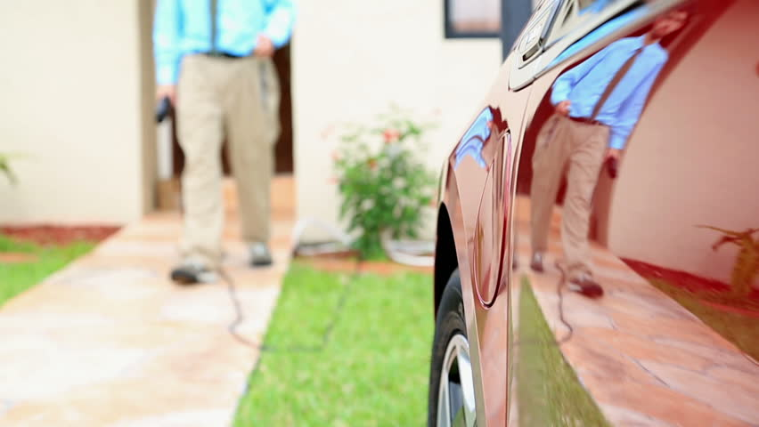 Electric vehicle being plugged in or unplugged | Shutterstock HD Video #4004536