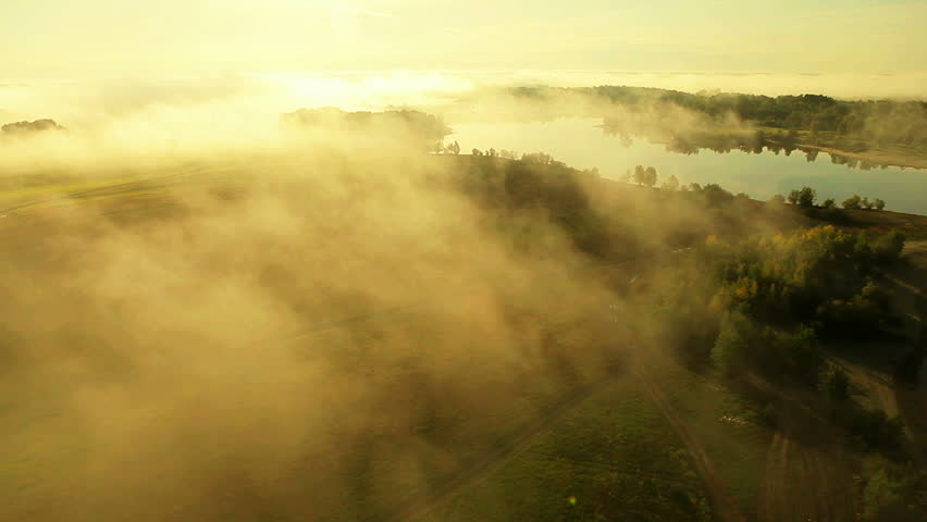 Aerial View. Flying over the beautiful river in clouds . Aerial camera shot. Sunrise. Landscape panorama. Altai, Siberia. | Shutterstock HD Video #4012195
