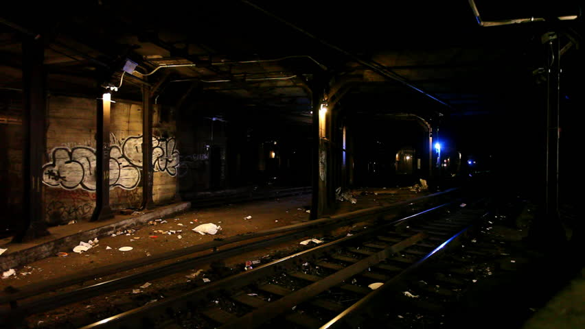 Subway passing in a dark and dirty tunnel with graffiti paintings on a wall / HD1080 / 29.97fps | Shutterstock HD Video #401257