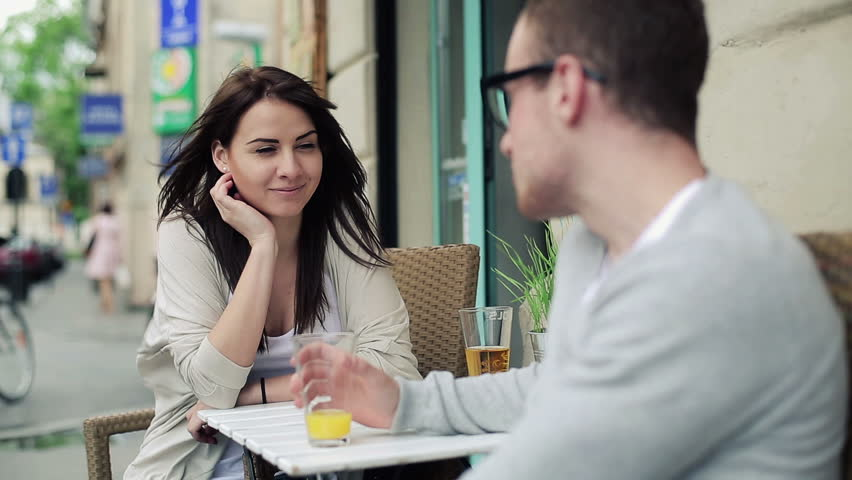 Young happy couple chatting in cafe, steadicam shot    Shutterstock HD Video #4012591