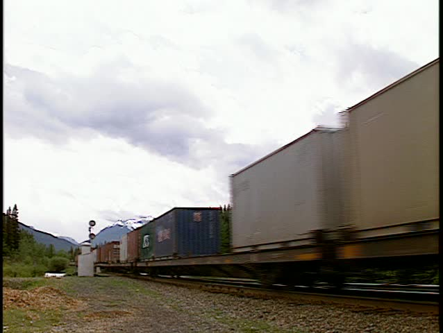 Train auto carriers intermodal wide shot going away (BetacamSP, good audio)