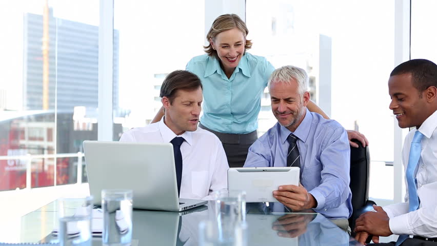 Group of business people using laptop and tablet computer during a meeting | Shutterstock HD Video #4051003