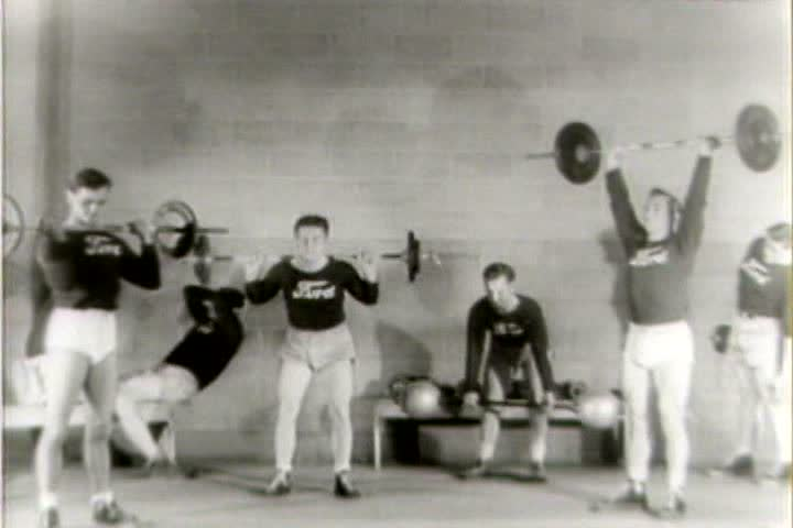 1940s - Amateurs lift weights in a gym in 1941.