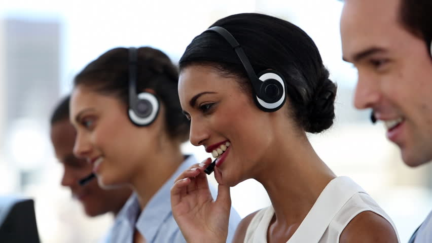 Call centre agents working in their bright office | Shutterstock HD Video #4055212