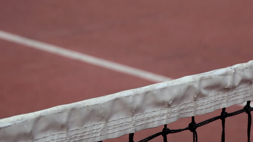 Tennis ball bouncing of the tennis net (slow motion HD clip, created with Canon EOS 5D mark II)
