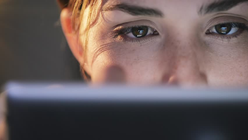 Woman using tablet computer touchscreen close-up