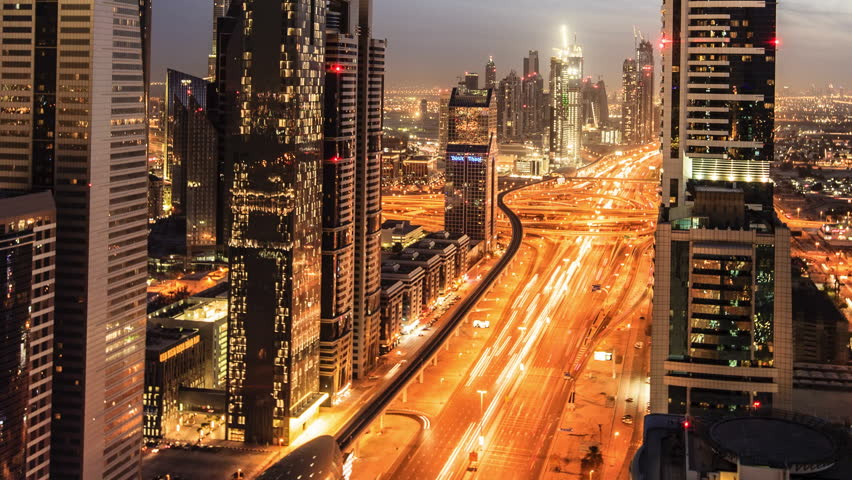 Busy traffic scene in the rush hour on Sheikh Zayed Road, Dubai's main road artery. Transition time-lapse from dusk to night in Dubai