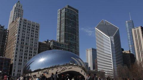 CHICAGO, USA - APRIL 14, 2013 The Famous Chicago Cloud Gate, The Bean Sculpture, Millennium Park, Skyline, Trump International Hotel