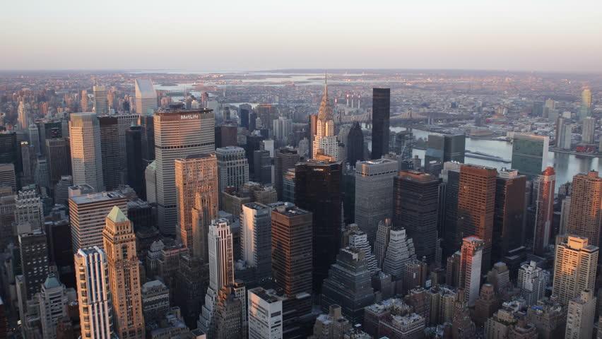 NEW YORK CITY - USA APRIL 18, 2013 Aerial View of New York City Skyline by sunset, Midtown Manhattan, Chrysler Building, Trump World, East River