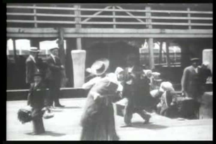 1900s - Immigrants arrive at Ellis Island, New York, in 1903. | Shutterstock HD Video #4097932