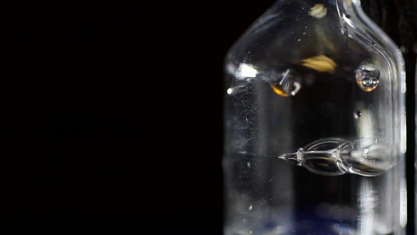 A bubbling fermentation airlock.