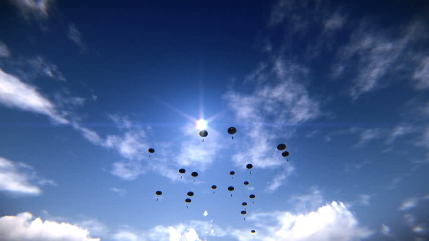 Several paratroopers descending in the sky