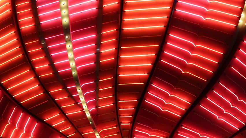 LAS VEGAS, USA - APRIL 2, 2013 Nightlife, Flamingo Hotel Casino Lights Display, Las Vegas Strip, Red Neon Flashing Illuminated Bulbs