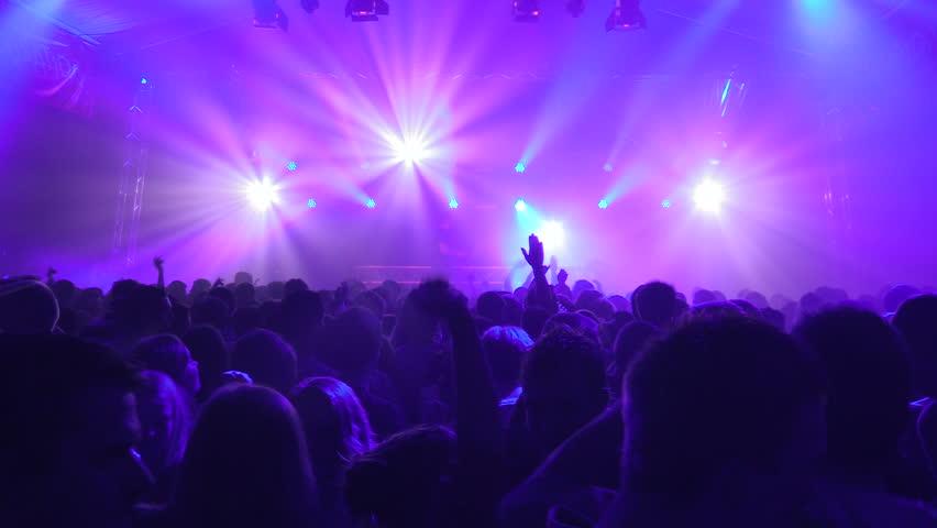 GRONINGEN, NETHERLANDS - APRIL 13: Light show and people dancing at a Dance Event on April 13, 2013 in Groningen, Holland #4106575