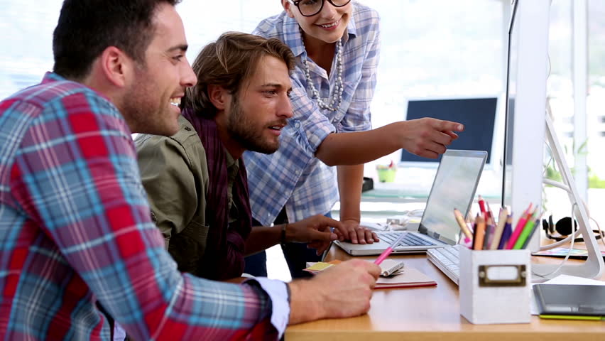 Team of designers working on computer together in their office   Shutterstock HD Video #4109638