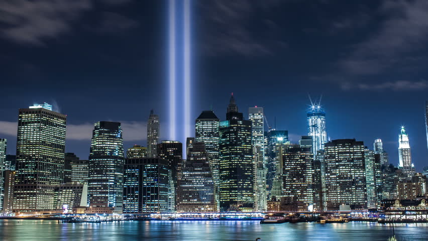 September 11th Lights in New York City - 911 Memorial Beams of Twin Towers at Night in NYC, USA, Commemorating the Tragedy of the Terrorist Attacks on the World Trade Center in Manhattan - Tilt Up