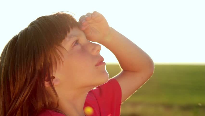 Boy looks at the sky, the boy closely watching the sky
